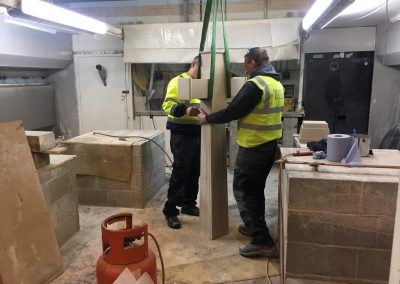 stonmasons seeing how they piece together